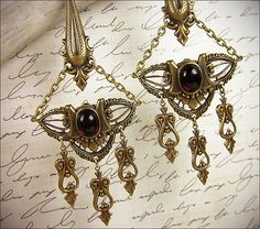 Antiqued Spikes surround a delicate filigree, displaying a smooth, Medieval jewel at its center.
