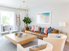 See 20 stunning spaces furnished with tan leather sofas and chairs. Get modern and vintage design ideas for living rooms and family rooms. Coastal Living Rooms, Living Room Decor, Living Spaces, Tan Leather Sofas, Brown Leather, Decoration Christmas, Types Of Sofas, Interiores Design, Furniture