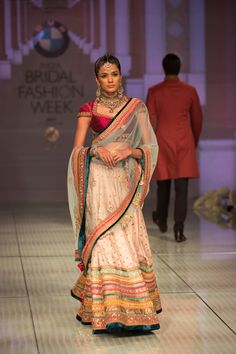 Tarun Tahiliani Indian bridal lehenga. More here: http://www.indianweddingsite.com/bmw-india-bridal-fashion-week-ibfw-2014-tarun-tahiliani-show/