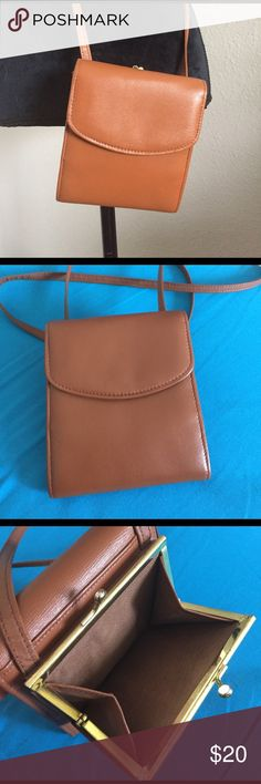 Small Brown Leather Crossbody This is so cute for necessities. Great for festivals and day trips! Genuine leather. I don't know where it's from, it's vintage. Some minor wear on strap and body (no peeling) and nick as pictured. Really great condition for being vintage. Teeny tiny: 5 by 5.5 inches. Strap hangs 25 inches. No trades. Vintage Bags Crossbody Bags