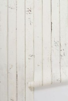 Scrapwood wallpaper via anthropologie...wow. and here I said I would never do wallpaper again...ever.