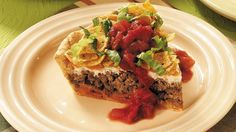 crescent-crusted taco pie in which crushed corn chips add just the right crunch!