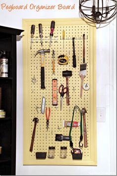A simple and easy pegboard organizer for the wall to keep small tools handy and in plain sight.  Pretty and functional!