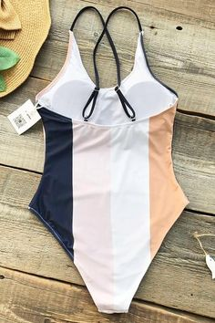 This is a swimsuit you want to have in your shopping list. Product Code: CYY21434 Details: Color blocking Cross at back Removable padding bra Adjustable shoulde