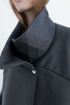 Innovative collar detail with tessellating triangles; fabric manipulation; geometric fashion detail // Bannet