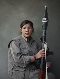 IRAQ. Bashur (Southern Kurdistan). Nineveh governorate. Mexmûr/Makhmour. March 2015. Sarya, a PKK fighter, with a RPG.