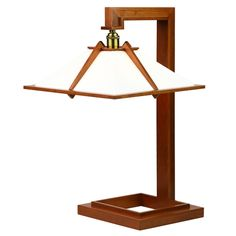 Frank Lloyd Wright originally designed the wooden table lamp for the interior of his own home, Taliesin, built in Spring Green, Wisconsin in Wooden Table Lamps, Rustic Lamps, Lamp Table, Frank Lloyd Wright, Luminaire Design, Lamp Design, Bedroom Lamps, Light Fixtures, Decoration