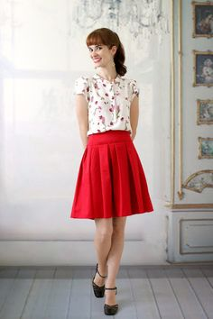 Super cute outfit. Love the top with the red pleated skirt and black shoes.