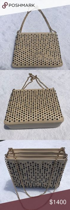 SOLD OUT!!! CHRISTIAN LOUBOUTIN TRILOUBI Bag Christian Louboutin gorgeous beige bag. This bag is called Triloubi, because it has three sections. This bag is beige and has brownish spikes, with gold hardware. This bag is gorgeous, edgy and very useful. It's a bag you can use and wear with so much. Causal or dressy!!! This bag is the large size and is sold out everywhere!!! If found it retails for $2250 + Tax!!! Christian Louboutin Bags Shoulder Bags