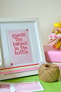 "Bottle Guessing Game.. love the frame idea and filled with ""jelly babies"".. could use sour patch kids?  This was a ladybug theme shower and is gorgeous!"