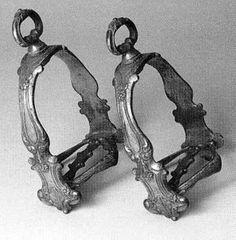 Gilded bronze stirrups dating from around 1680 - 1700 from France or Italy in Museo Storico della Caccia e del Territorio