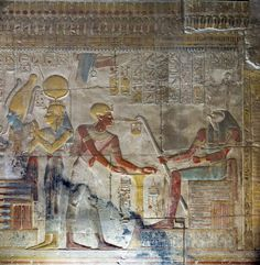 Seti I, dressed as a priest next to the offering table in front of Horus, behind them Isis and Osiris. Temple of Seti I at Abydos. Egyptian Pharaohs, Ancient Egyptian Art, Ancient Aliens, Ancient History, Objets Antiques, Art Antique, Egypt Art, Les Religions, Ancient Artifacts