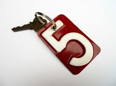 license plate keychain. would be cool to use on a scrapbooking page or in a shadow box, on a wall in a childs room..possibilities are endless!