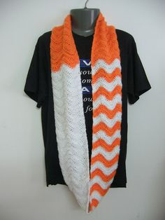 I like the solid blocks of color with chevron in between blending them - would look great with my pumpkin and spice yarn