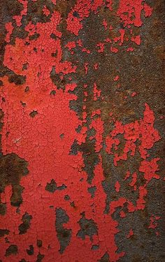 red paint gradually replacedby a deeper organic texture of ochre rust