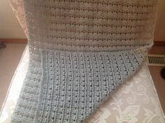 Tunisian Crochet Shawl. Pattern 34 from '101 Easy Tunisian Stitches'. DK Yarn, 6.5 mm Tunisian crochet hook, and a lovely, easy repetitive pattern that's easy to memorize. This lightweight, lacy shawl will be donated to a seniors' care facility. ~ Leslie Molengraaf