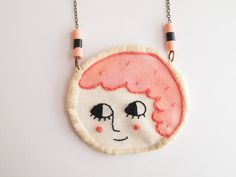 Happy face, embroidered necklace. $26.00, via Etsy.