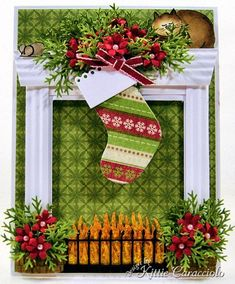 Kittie Kraft re-made the fireplace card, adding fire, screen, greenery