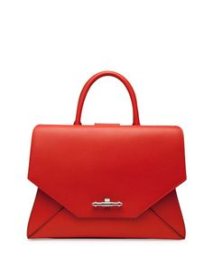 """Givenchy grained """"sugar"""" goatskin with shiny palladium hardware. Rolled tote handles; 4"""" drop. Flat shoulder strap; 11"""" drop. Extended zip top. Envelope flap detail with metal logo lettering. Inside,"""