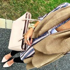 IG @mrscasual <click through to shop this look> Camel long vest $15.  Lush printed tunic.  Skinny jeans.  Nude flats.  Tory burch york tote.  Lariat necklace.