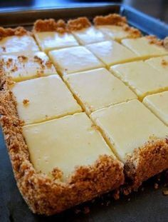 CREAMY LEMON SQUARES: FOR THE CRUST 4 tablespoons butter, melted and cooled, plus more for pan cup graham cracker crumbs ¼ cup sugar FOR THE FILLING 2 large egg yolks 1 can ounces) sweetened condensed milk ½ cup fresh lemon juice lemons) How 13 Desserts, Easy Lemon Desserts, Key Lime Desserts, Icebox Desserts, Potluck Desserts, Lemon Dessert Recipes, Thanksgiving Desserts, Party Desserts, Fruit Recipes