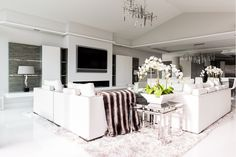 Modern lounge with floating media wall from Herrington Gate