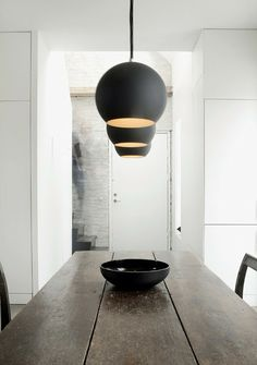 Follow modern lighting trends by placing pendants in rows of three above dining tables or islands.
