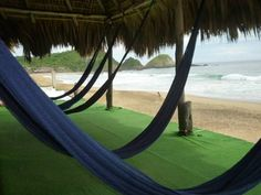 Hotel Lyoban Zipolite Offering an outdoor pool and a restaurant, Hotel Lyoban is located in Zipolite, right on the beach. Free Wi-Fi access is available. The rooms at this hostel come with a seating area, a fan and mosquito nets.
