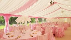 Pink & ivory decor installed with wedding marquee by www.24carrotevents.co.uk