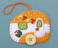 Vintage caravan trailer ornament, handmade from felt and decorated with fabric scraps. With tiny felt bunting and buttons for the wheel and door knob. Colors are orange and white. With blanket stitche Felt Christmas Decorations, Felt Christmas Ornaments, Handmade Ornaments, Handmade Felt, Handmade Christmas, Christmas Tree, Beaded Ornaments, Glass Ornaments, Felt Crafts