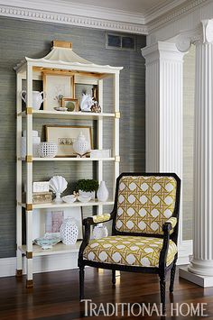 A stylish chair pairs with a white étagère for a pretty vignette in the parlor. - Photo: Werner Straube / Design: Corey Damen Jenkins