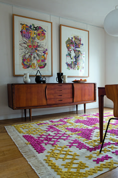 This week while organizing my Pinterest boards (that's right I'm really doing it) I ran across this photo I pinned months ago. I love this cross stitch designed rug and have searched fo…