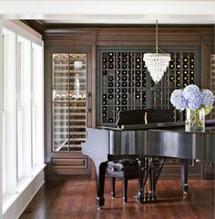 Wine & Music Room: a former dining room was converted into a wine and music room. Wine kept in walnut cubbies and two Sub-Zero wine chillers is easily accessible from both the dining room and the kitchen