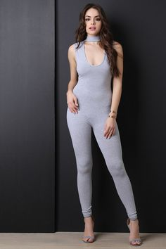 2ae2cf557835 This jumpsuit features a keyhole window cutout yoke