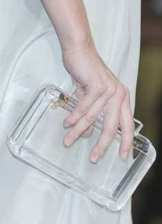 Glass clutch. Why not just carry around a decorate glass cube used in construction? About as useful as this accessory.