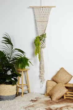 Macrame hanger handmade with cotton rope and copper detail beads.  For indoor (or outdoor covered) use.  Perfect for a pot plant or a vase of beautiful flowers.  Sold without the glass vase.  Des…