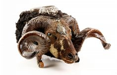 """19th century, Scottish snuff mull, ram's head trophy on casters, silver mountings and glass eyes, hallmarked Edinburg circa 1870, this was part of the original furnishings from the Brooks Brothers on Madison Ave in New York, NY showroom, 11"""" x 18 1/2"""" x 20"""". Provenance: NH estate."""