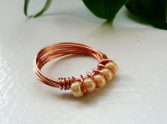 Ivory Seed Beads - Copper Wire Wrapped Ring. $10.00, via Etsy.
