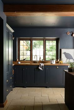 Take a tour of this beautifully dark and atmospheric kitchen that mixes traditional style with industrial elements to create a truly memorable room.