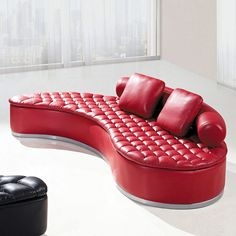Create a comfortable place in your home to gather with family and friends with this contemporary Sectional Sofa by Global Furniture. This sectional features ultra comfort seating, plush biscuit tufted detailing and a rounded back with throw pillows. Rich red bonded leather adds to the modern appeal of this sectional.