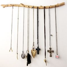 A bunch of different DIY jewelry displays. This is super easy- use those tiny nails on a stick!