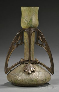 Loetz-style Art Nouveau Glass and Gilt-metal Vase, tulip-shaped top over slender neck above spot- and line-decorated sage green ovoid body, mounted with stylized leaf forms.