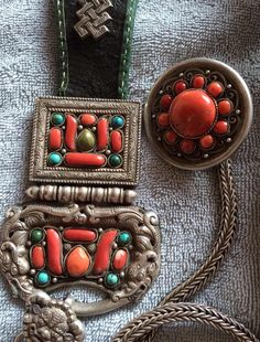Mongolian belt pendant and toggle set. Silver, coral, turquoise, leather