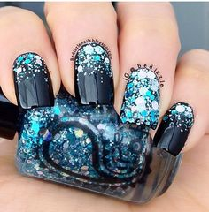 Gorgeous dark blue nails with bright blue and silver glitters