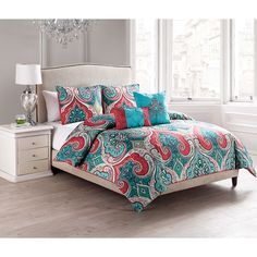 This comforter set will dress your bedroom in an exotic and colorful scheme. It includes a reversible comforter, two shams and two pillows. Comes in queen and king sizes.