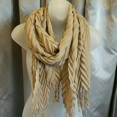 HP10/20 Lovely tan scarf for fall season Don't forget to grab this scarf as you prepare your wardrobe!! This chic tan scarf goes with anything and has such lovely texture.  Good condition. Light weight    Accessories Scarves & Wraps