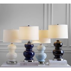 Pottery Barn Alexis Ceramic Bedside Lamp Base ($60) via Polyvore featuring home, lighting, table lamps, colored lights, blue and white ceramic lamp, cream ceramic lamp, cream table lamps and pottery barn table lamps