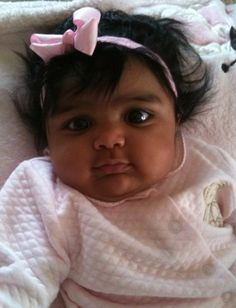 Pretty in pink. African American baby.