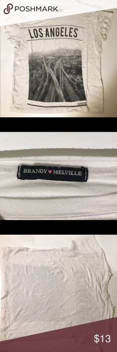 Brandy Melville LA Crop Top Super soft and stretchy white Brandy Melville crop top. This top is one size but fits XS best. Brandy Melville Tops Crop Tops