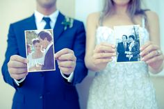 Each holding their parents' wedding pictures